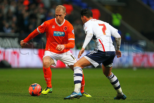 04.01.2014 Bolton, England. Neil Bishop of Blackpool in action against Eagles of Bolton during the FA Cup 3rd Round game between Bolton Wanderers and Blackpool from the Reebok Stadium.