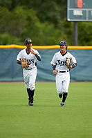 GCL Rays outfielders Daiwer Castellanos (5) and Shane Sasaki (8) during a Gulf Coast League game against the GCL Pirates on August 7, 2019 at Charlotte Sports Park in Port Charlotte, Florida.  GCL Rays defeated the GCL Pirates 4-1 in the first game of a doubleheader.  (Mike Janes/Four Seam Images)
