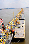 {8/24/12} {10pmCST} Greenville , MS, U.S.A. --Workers on The Dredge JADWIN, of the US Army Corp of Engineers, begin dredging a stretch of the Mississippi River 7 miles downriver from Greenville MS. where the Army Corp of Engeineers is dredging the river to keep it open to tug boat traffic. Pictured workers connect the JADWIN to a 1000 foot pipeline to carry out the sludge.  Sandbars creep up as the water level drops on the Mississippi River makeing navigating the Mississippi River difficult for tug boat captains, Friday August 24,2012. Historically low river levels on the Mississippi River are causing havoc on river traffic: grounding barges loaded with grain and fertilizer, traffic jams several miles long and forcing the Coast Guard to close down chunks of the river due to groundings. The area around Greenville, Miss., has closed three times the past week due to groundings. © Photo © Suzi Altman..