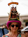"SARATOGA SPRINGS, NY - AUGUST 25: A woman wears a decorative hat saying ""Wish You Were Here"", with ""Justify"" emblazoned on the brim on Travers Stakes Day at Saratoga Race Course on August 25, 2018 in Saratoga Springs, New York. (Photo by Carson Dennis/Eclipse Sportswire/Getty Images)"