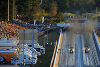 Jan. 20, 2012; Jupiter, FL, USA: Aerial view of a pair of NHRA top fuel dragster drivers racing down track during testing at the PRO Winter Warmup at Palm Beach International Raceway. Mandatory Credit: Mark J. Rebilas-