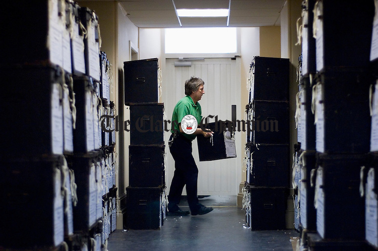 Clare County Council's Peter Sheridan getting ready the ballot boxes for the general election. Photograph by John Kelly.