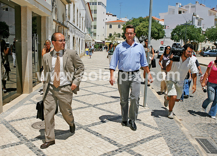 **ALL ROUND PICTURES FROM SOLARPIX.COM**.**WORLDWIDE SYNDICATION RIGHTS**.Main suspect in the Madeleine McCann abduction case, Robert Murat was today at Potimao police station on the Algarve for further questioning. Here he is seen with his lawyer Francisco Pagarete outside the police station..JOB REF:     4244            DATE: 10.07.07.**MUST CREDIT SOLARPIX.COM OR DOUBLE FEE WILL BE CHARGED* *UNDER NO CIRCUMSTANCES IS THIS IMAGE TO BE REPRODUCED FOR ANY ONLINE EDITION WITHOUT PRIOR PERMISSION*