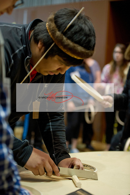 Frank Jack, a Tliingit Indian from Juneau notches his drum as a workshop on drum making begins at the Youth and Elders conference during Alaska Federation on Natives week Monday Oct. 12, 2015.  Photo for the Journal by Michael Dinneen