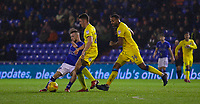 Oldham Athletic's Jack Byrne (L) under pressure from  AFC Wimbledon's Anthony Hartigan during the Sky Bet League 1 match between Oldham Athletic and AFC Wimbledon at Boundary Park, Oldham, England on 21 November 2017. Photo by Juel Miah/PRiME Media Images