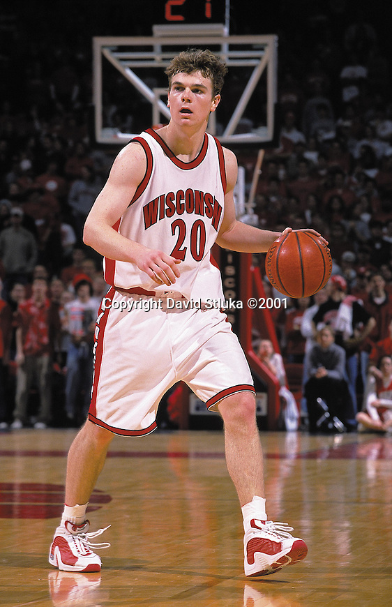 University of Wisconsin guard Kirk Penney #20 handles the ball against the Northwestern Wildcats on 2/18/01 at the Kohl Center in Madison, Wisconsin. (Photo by David Stluka)
