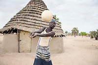 Young woman from the Turalei volleyball team parctices during the Twic Olympics in Wunrok, Southern Sudan.