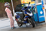 © Joel Goodman - 07973 332324 . 16 August 2013 . Manchester , UK . Pillion passenger , a woman in a onesie and helmet , at Tesco petrol station in Eccles . Drive along with Inspector Matt Bailey-Smith ( 16366 ) of Greater Manchester Police 's Serious Collision Unit . Photo credit : Joel Goodman