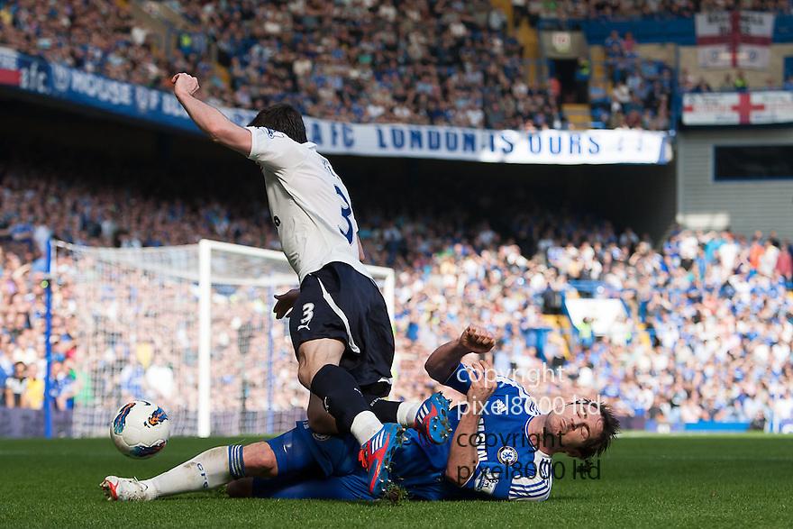 London, UK. Chelsea midfielder Frank Lampard fouls Tottenham left winger Gareth Bale during Barclays Premier League fixture Chelsea versus Tottenham Hotspur at Stamford Bridge 24 Mar.  Byline David Fearn Pixel 8000 Ltd
