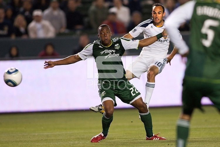 Landon Donovan (10) navigates past Rodney Wallace (22) of the Portland Timbers and sends a ball to the goal. The LA Galaxy defeated the Portland Timbers 3-0 at Home Depot Center stadium in Carson, California on  April  23, 2011....