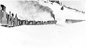Four C-16s push rotary snowplow approaching the first snowshed after the loop.<br /> D&amp;RG  Cumbres, CO  circa 1910-1912