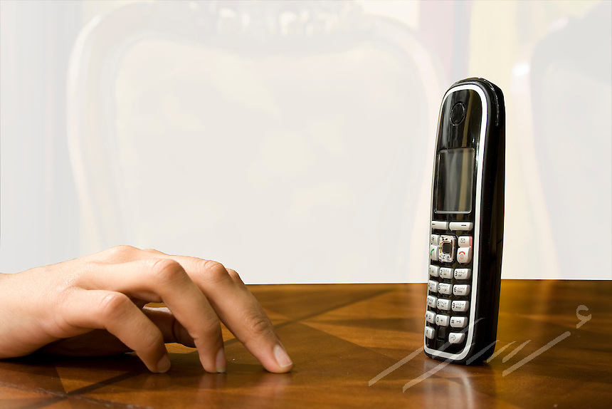 A woman awaiting a call.