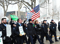 Wisconsin police protest Wisconsin state worker law changes at the Wisconsin State Capitol in Madison