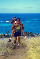 Couple hiking Kaiwa Ridge trail, above Lanikai, windward Oahu