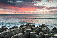 Sunset over limestone formations, Pancake Rocks, in Punakaiki, Paparoa National Park, Buller Region, West Coast, South Island, New Zealand, NZ