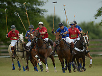 NWA Democrat-Gazette/ANDY SHUPE<br />  Brian Buell (right) strikes the ball Saturday, Sept. 8, 2018, as he leads a pack of players during the 29th annual Polo in the Ozarks at the Buell Farm in Goshen. This event features a polo match, games, vendors, music and food to benefit Life Styles Inc.