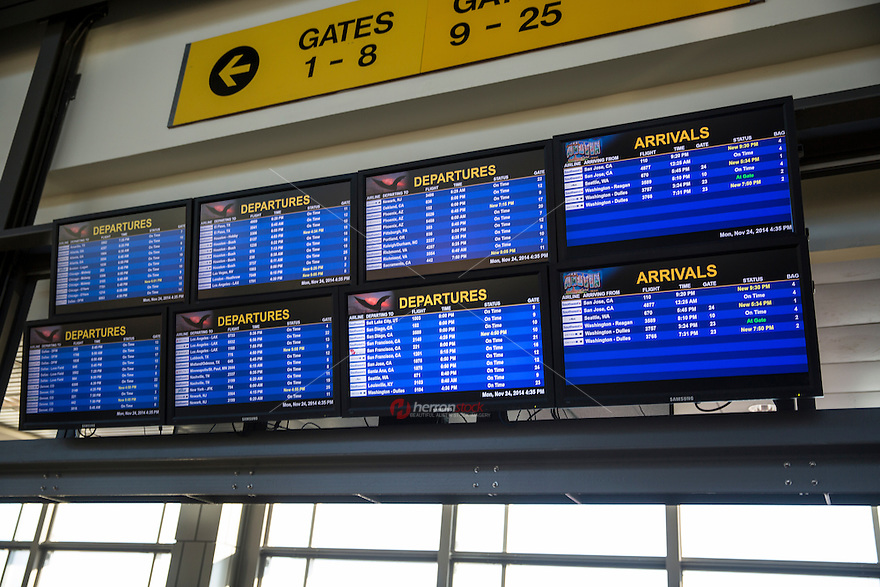 Flight information display monitors show current arrival and departure times at ABIA - Austin Bergstrom International Airport