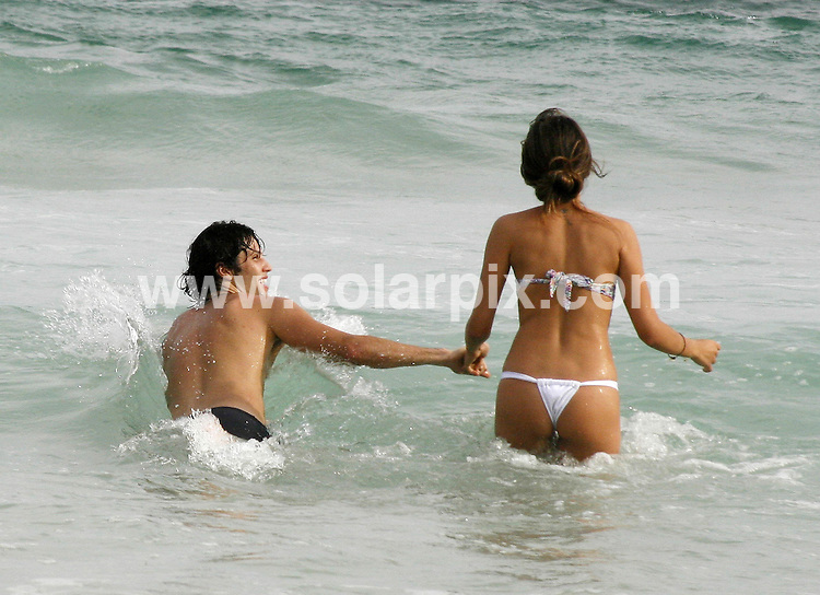 **ALL ROUND PICTURES FROM SOLARPIX.COM**.**SYNDICATION RIGHTS FOR UK AND SPAIN ONLY**.Brazilian actor Gustavo Leao and sexy girlfriend were spotted in a romantic atmosphere enjoying the Pepe beach, west area of Rio de Janeiro, Brazil. 30 January 2010..This pic: Gustavo Leao and girlfriend ..JOB REF: 10606 PRT        DATE: 30_01_2010.**MUST CREDIT SOLARPIX.COM OR DOUBLE FEE WILL BE CHARGED**.**MUST NOTIFY SOLARPIX OF ONLINE USAGE**.**CALL US ON: +34 952 811 768 or LOW RATE FROM UK 0844 617 7637**