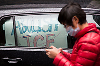 NEW YORK, NY - APRIL 24: A woman covers her face as she attends a car protest demanding to release ICE detainees in  due to Coronavirus on April 24, 2020 in New York City. Some people in cars and bicycles approached Governor Andrew Cuomo's office to demand the opening of ICE jails in New York State, as the governor has emergency powers to order the release of all ICE detainees.Photo by Pablo Monsalve / VIEWpress via Getty Images)
