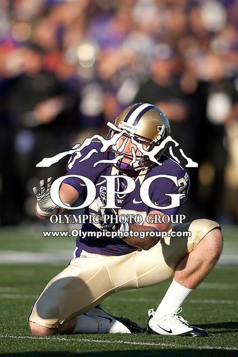 Sept 3, 2011:  Washington place holder #27 William Chandler waits for the snap against Eastern Washington.  Washington defeated Eastern Washington 30-27 at Husky Stadium in Seattle, Washington...