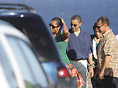 Honolulu, HI - December 23, 2008 -- United States President-elect Barack Obama, left center, along with wife Michelle Obama, left, and sister Maya Soetoro-Ng, right center, and long-time family friend Bobby Titcomb, right, return from a seaside memorial on the south-eastern coast of Oahu, Tuesday, December 23, 2008 in Honolulu, Hawaii.  .Credit: Kent Nishimura - Pool via CNP