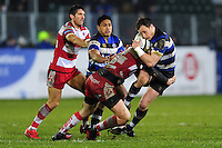 Jack Wilson of Bath Rugby is tackled in possession. Anglo-Welsh Cup match, between Bath Rugby and Gloucester Rugby on January 27, 2017 at the Recreation Ground in Bath, England. Photo by: Patrick Khachfe / Onside Images