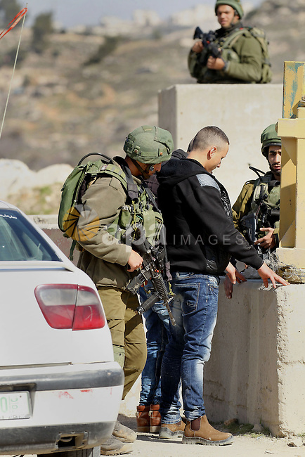 Israeli border policemen detain a Palestinian man during clashes following a demonstration against the construction of Jewish settlements in the occupied West Bank city of Hebron, on February 10, 2017. Photo by Wisam Hashlamoun