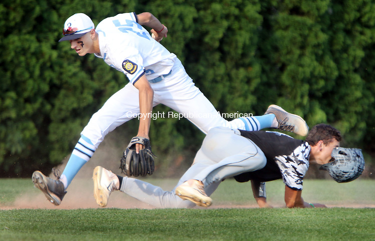 WATERTOWN CT. 18 July 2017-071817SV05-#25 Adam Stone of Stamford Post 3 tags out #14 Adam Razza of Oakville Post 195 between 3rd and home in the first inning of Legion baseball action in Watertown Tuesday.<br /> Steven Valenti Republican-American