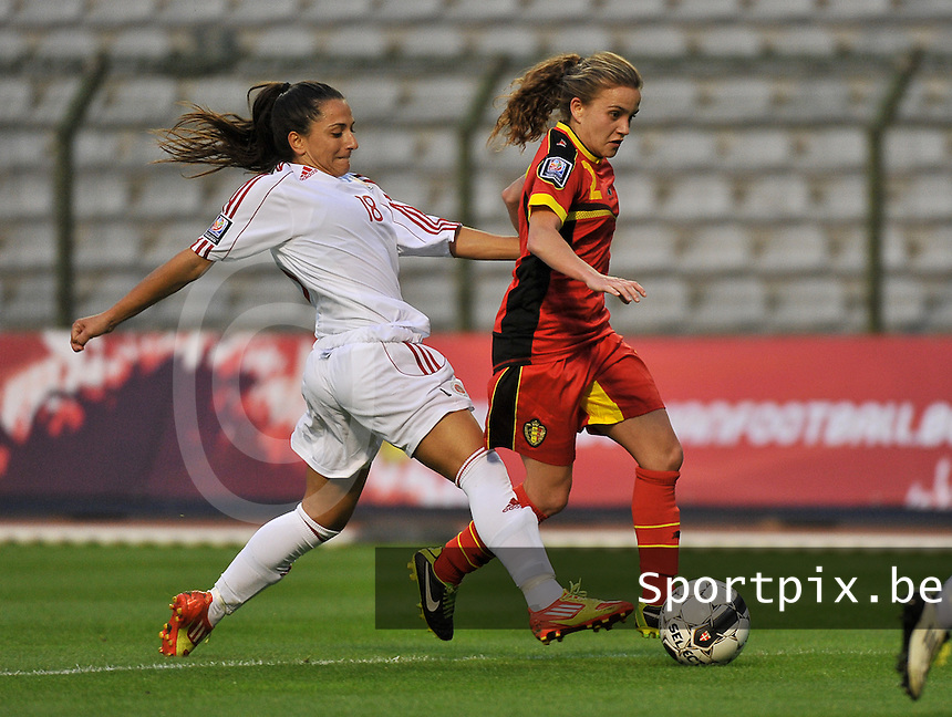 20130921 - BRUSSELS , BELGIUM : Belgian Davina Philtjens (2) pictured tackled by Albanian Denisa Proto (18) during the female soccer match between Belgium and Albania , on the first matchday in group 5 of the UEFA qualifying round to the FIFA Women World Cup in Canada 2015 at the Koning Boudewijn Stadion , Brussels . Saturday 21th September 2013. PHOTO DAVID CATRY