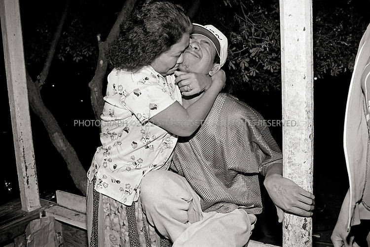 11/1995--Bakersfield, CA. Gino's mother hugs him at their home in Bakersfield, CA....All photographs ©2003 Stuart Isett.All rights reserved.This image may not be reproduced without expressed written permission from Stuart Isett.