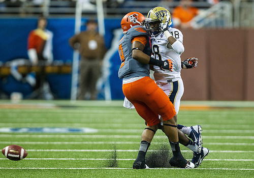 December 26, 2013:  Pittsburgh defensive back Titus Howard (18) interferes with Bowling Green wide receiver Shaun Joplin (9) during NCAA Football game action between the Pittsburgh Panthers and the Bowling Green Falcons at Ford Field in Detroit, Michigan.  Pittsburgh defeated Bowling Green 30-27.