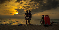 Fine Art photograph of people watching a beautiful sunset in Puerto Vallarta, Mexico.
