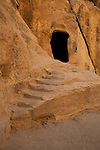 Carved steps leading to a burial chamber in Little Petra
