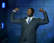Canton, Ohio - August 1, 2014: Former Defensive End Michael Strahan poses for the audience as he is introduced before accepting his gold jacket during the Pro Football Hall of Fame's class of 2014 enshrinement dinner in Canton, Ohio  August 1, 2014. Strahan had 22.5 sacks in a single season (2001) and lead the NFL in sacks in 2001 and 2003.  (Photo by Don Baxter/Media Images International)