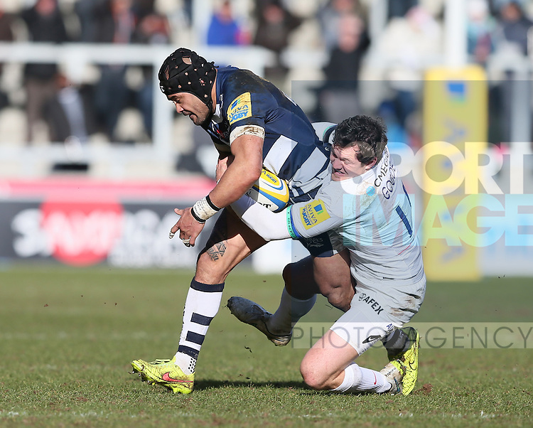 Sam Tuitupou of Sale Sharks tackled by Alex Goode of Saracens - Aviva Premiership - Sale Sharks vs Saracens - AJ Bell Stadium Stadium - Salford - Manchester - England - 21st February 2015 - Picture Simon Bellis/Sportimage
