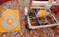 Una stampante 3D per la produzione di pasta alla Maker Faire, mostra sull'innovazione tecnologica, a Roma, 4 ottobre 2014.<br /> A 3D printer for the production of pasta is displayed at the Maker Faire exhibition on technological innovation in Rome, 4 October 2014.<br /> UPDATE IMAGES PRESS/Riccardo De Luca