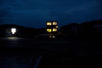 Night view of a building and vending machines near Route 45 following the 311 Tohoku Tsunami in Otsuchi, Japan  © LAN