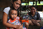 Twenty three years later: Forty year old Den Along (RHS) daughter of Along Sega, with her daughter Senorita (LHS), who is now 24 yrs old, and Senorita's two year old son Dimas. They are indigenous Penan native people, who were once nomadic hunter gatherers and are now settled. Long Gita, Limbang district, Sarawak, Borneo 2012<br />