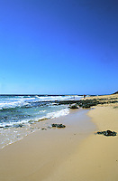 People standing on sandy beach and Atlantic waves, Fuerteventura,Canary Islands.deserted,people,couple with child