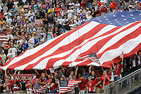 United States (USA) fans unfurl a giant American flag for the playing of the national anthem. The United States and Haiti played to a 2-2 tie during a CONCACAF Gold Cup Group B group stage match at Gillette Stadium in Foxborough, MA, on July 11, 2009. .