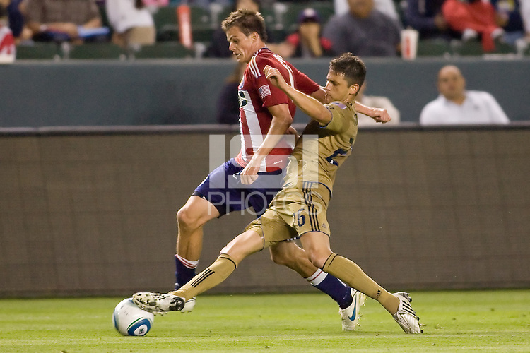 Philadelphia Union defender Christian Arrieta (26) pushes the ball away from CD Chivas USA forward Justin Braun (17). The Philadelphia Union and CD Chivas USA played to 1-1 draw at Home Depot Center stadium in Carson, California on Saturday evening July 3, 2010..