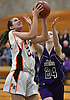 Alessia Drevnyak of East Rockaway, left, drives to the net during the Class C varsity girls basketball Long Island Championship against Port Jefferson at SUNY Old Westbury on Monday, March 6, 2017.