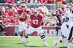 Wisconsin Badgers offensive lineman Jon Dietzen (67) pass blocks as quarterback Alex Hornibrook (12) looks for a receiver during an NCAA College Football game against the Florida Atlantic Owls Saturday, September 9, 2017, in Madison, Wis. The Badgers won 31-14. (Photo by David Stluka)