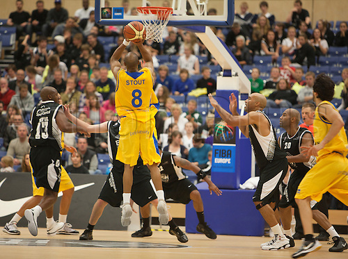 24.09.2010 British Basketball League Newcastle Eagles v Sheffield Sharks..Marcus Stout (8) Sharks Guard jumps to get in a shot despite severe defense from the Eagles.