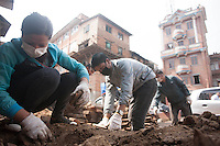 Volunteers remove the ruble from a destroyed house. Shanku, Kathmandu, Nepal. May 9, 2015