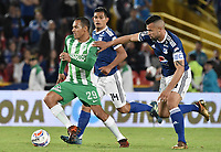 BOGOTA - COLOMBIA, 31-01-2018: Andres Cadavid (Der) jugador de Millonarios disputa el balón con Aldo Leao Ramirez (Izq) jugador de Atlético Nacional durante partido partido por la final ida de la SuperLiga Aguila 2018jugado en el estadio Nemesio Camacho El Campin de la ciudad de Bogotá. / Andres Cadavid (R) player of Millonarios fights for the ball with Aldo Leao Ramirez (L) player of Atletico Nacional during the first leg match for the final of the SuperLiga Aguila 2018played at the Nemesio Camacho El Campin Stadium in Bogota city. Photo: VizzorImage / Gabriel Aponte / Staff.
