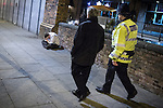 © Joel Goodman - 07973 332324 . FILE PICTURE DATED 05/05/2013 of Manchester's Police and Crime Commissioner , Tony Lloyd (centre) on overnight patrol with PC Gary Cave in Central Manchester (right) passing a man sitting on the pavement with his head in his hands , as the British Home Secretary , Theresa May , takes questions at the annual Police Federation conference on licensing and policing the night time economy , today (Wednesday 15th May 2013) . Photo credit : Joel Goodman