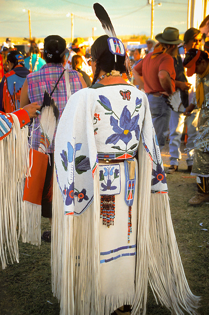 Beadwork of an iris flower design on the back yoke and purse of a Blackfeet ladies traditional pow wow outfit