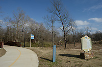 NWA Democrat-Gazette/ANDY SHUPE<br /> A sign marks the origin of the Razorback Greenway on the trail south of 15th Street in Fayetteville. About $6.9 million in trail projects is included in the $226 million bond referendum city voters will decide April 9. Included in those projects is an extension of St. Paul trail from the industrial park east across the West Fork of the White River, connecting to neighborhoods east of the river.