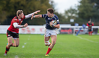 Jason Harries of London Scottish sprints forward holding off Tom Howe of Jersey during the Greene King IPA Championship match between London Scottish Football Club and Jersey at Richmond Athletic Ground, Richmond, United Kingdom on 7 November 2015. Photo by Andy Rowland.